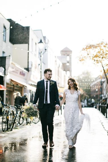 Bride and groom steal a moment wearing Phase Eight Wedding Dress