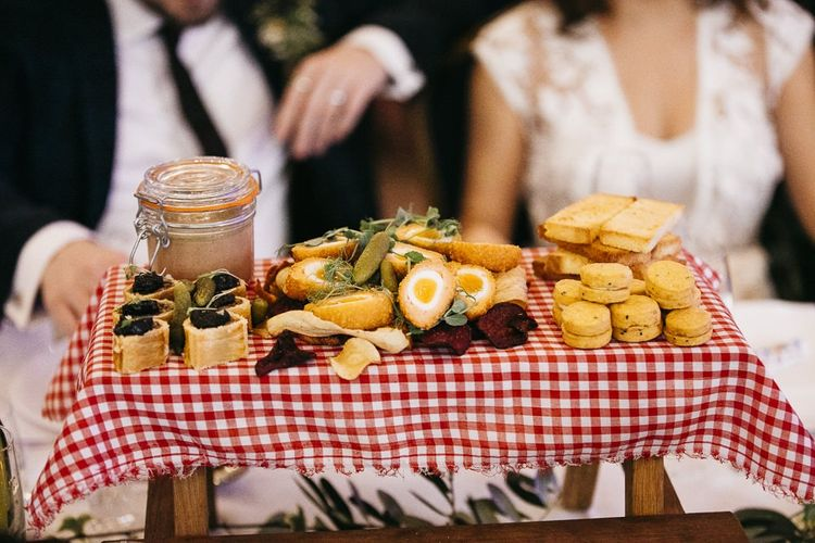 Food at reception with red gingham styling