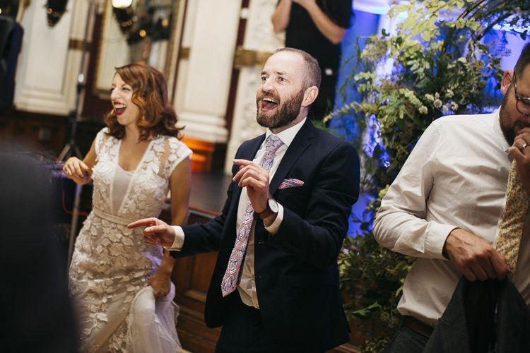 Bride and groom dance with their friends and family