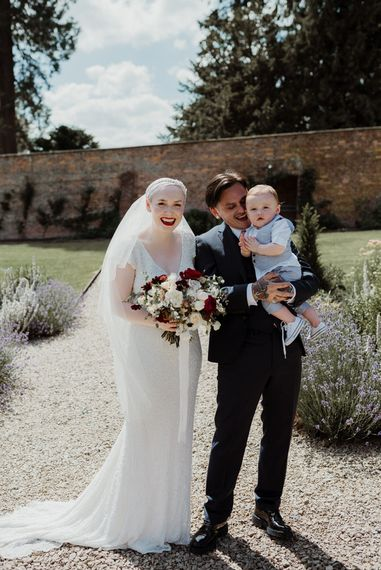 Bride with Short Hair in 1920s Eliza Jane Howell Wedding Dress and Groom in Marks and Spencer Suit  With Their Son