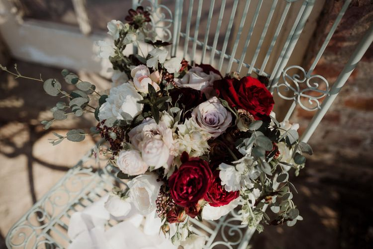 White and Red Rose Wedding Bouquet on Chair