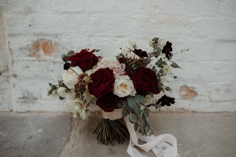 White and Red Rose Wedding Bouquet Tied up with Ribbon