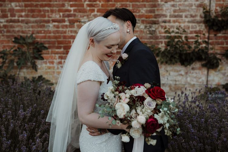 Bride with Short Hair in Eliza Jane Howell Wedding Dress and Groom in Marks and Spencer Suit Embracing