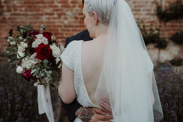 Bride with Short Hair in Beaded  Wedding Dress and Veil