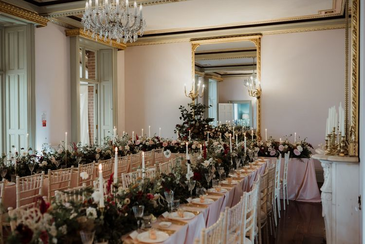 Garthmyl Hall Wedding Reception Venue Decorated with Red and White Floral Arrangements