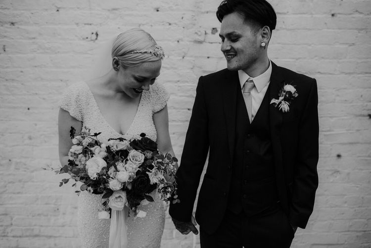 Bride with Short Hair in Eliza Jane Howell Wedding Dress and Groom in Marks and Spencer Suit Holding Hands