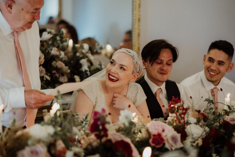 Bride with Short Hair and Red Lipstick Laughing During Father of The Bride Wedding Speech
