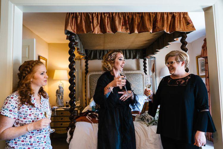 Wedding Morning Preparations | Bridal Party Champagne | Edison Bulb Floral Installation at Kingsthorpe Lodge Barn Wedding | Johnny Dent Photography