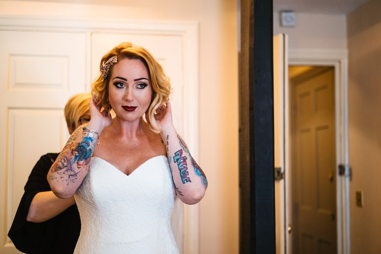 Wedding Morning Preparations | Bride in Strapless Sassi Holford Wedding Dress with Sweetheart Neckline | Edison Bulb Floral Installation at Kingsthorpe Lodge Barn Wedding | Johnny Dent Photography