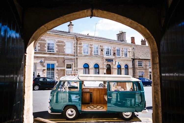 Wedding Transport | Turquoise Camper Van | Edison Bulb Floral Installation at Kingsthorpe Lodge Barn Wedding | Johnny Dent Photography