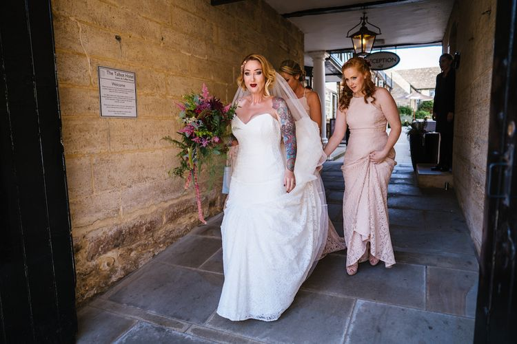 Arrival of the Bride | Bride in Strapless Sassi Holford Wedding Dress with Sweetheart Neckline | Bridesmaids in Pink Dessy Dresses | Edison Bulb Floral Installation at Kingsthorpe Lodge Barn Wedding | Johnny Dent Photography