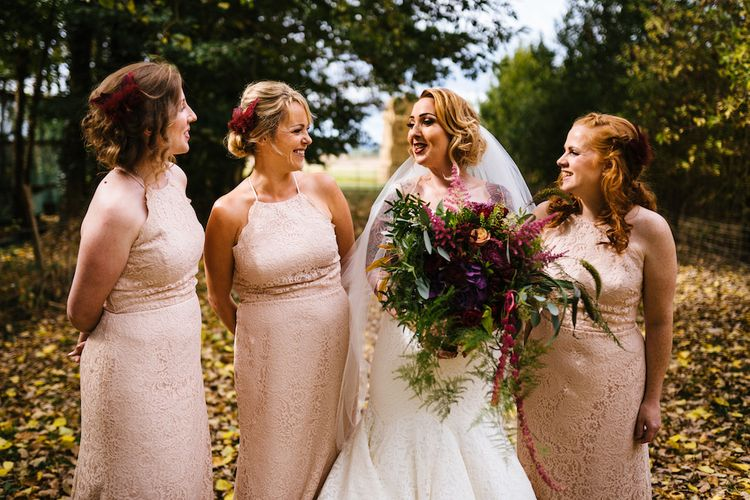 Bride in Strapless Sassi Holford Wedding Dress with Sweetheart Neckline | Bridesmaids in Pink Dessy Dresses | Edison Bulb Floral Installation at Kingsthorpe Lodge Barn Wedding | Johnny Dent Photography