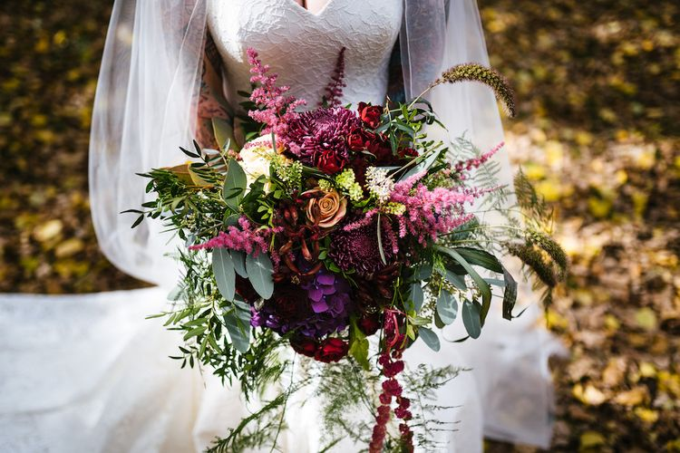 Bright Bouquet | Bride in Strapless Sassi Holford Wedding Dress with Sweetheart Neckline | Edison Bulb Floral Installation at Kingsthorpe Lodge Barn Wedding | Johnny Dent Photography