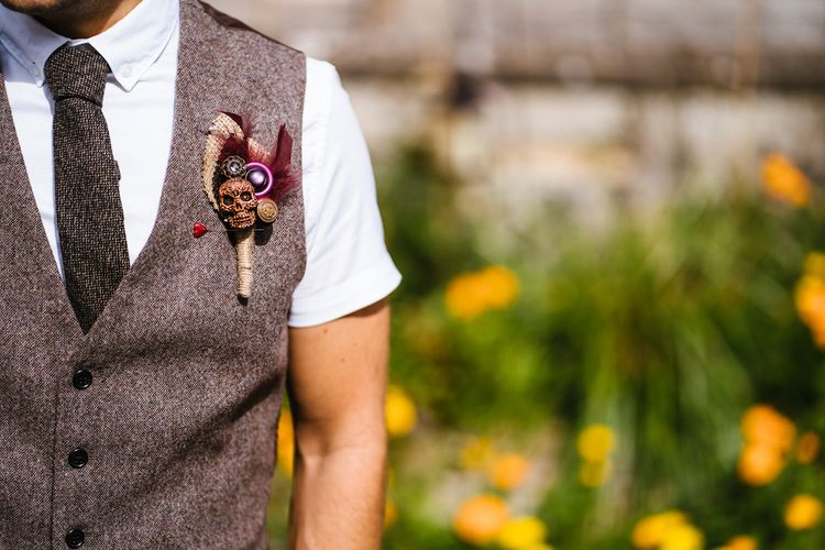 Tweed Waistcoat with Skull & Feather Buttonhole | Edison Bulb Floral Installation at Kingsthorpe Lodge Barn Wedding | Johnny Dent Photography