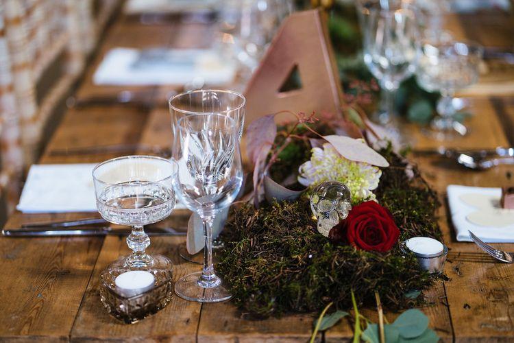 Wedding Reception Decor | Banquet Tables | Moss Garlands | Glass Skulls | Edison Bulb Floral Installation at Kingsthorpe Lodge Barn Wedding | Johnny Dent Photography