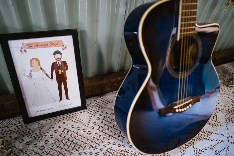 Wedding Reception Decor | Blue Guitar | Edison Bulb Floral Installation at Kingsthorpe Lodge Barn Wedding | Johnny Dent Photography