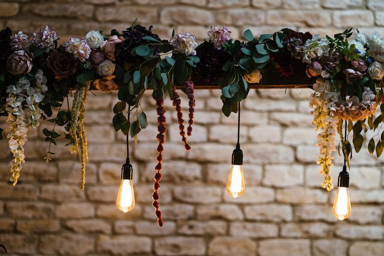 Wedding Reception Decor | Eddison Bulbs Hanging from Floral Installation | Edison Bulb Floral Installation at Kingsthorpe Lodge Barn Wedding | Johnny Dent Photography