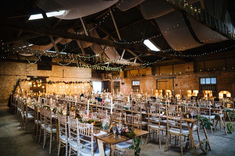 Wedding Reception Decor | Banquet Tables | Festoon Lights | Edison Bulb Floral Installation at Kingsthorpe Lodge Barn Wedding | Johnny Dent Photography