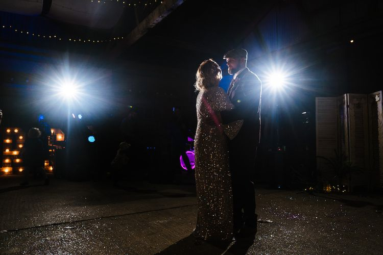 First Dance | Bride in Sequinned Kimono from ASOS | Groom in Burgundy Tweed Three Piece Suit | Edison Bulb Floral Installation at Kingsthorpe Lodge Barn Wedding | Johnny Dent Photography