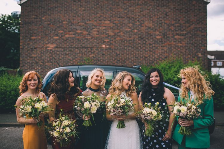Bride In Bridal Trainers With Mismatched Bridesmaids