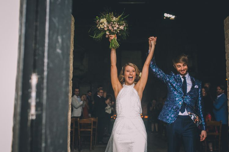 Bride and Groom Celebrate Coming Out Of Venue
