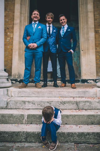 Grooms and Groomsmen With Kids At Wedding