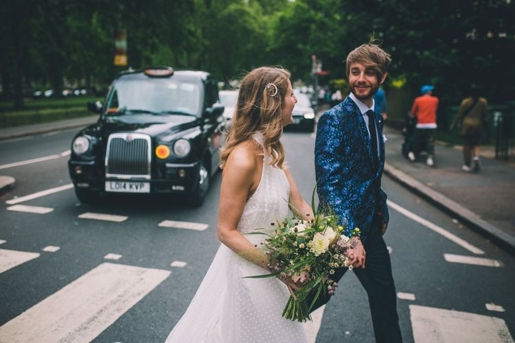 Groom Wears Patterned Suit and Bride Wears Bridal Trainers