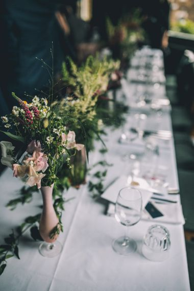 Wedding Decor With Flowers For Tables With Bride in Bridal Trainers