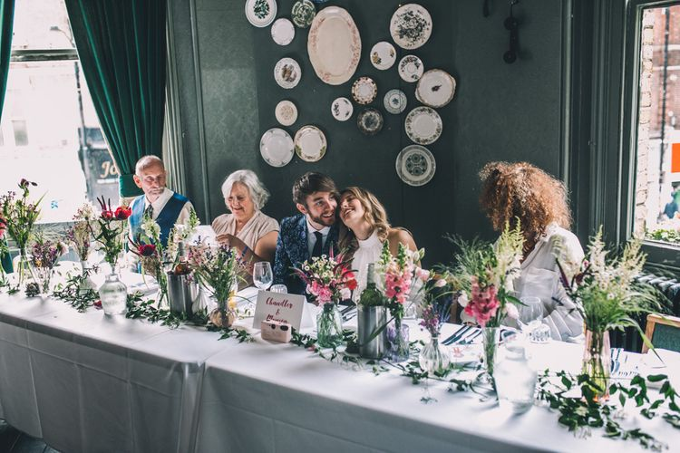 Bride and Groom Enjoy Reception On Top Table