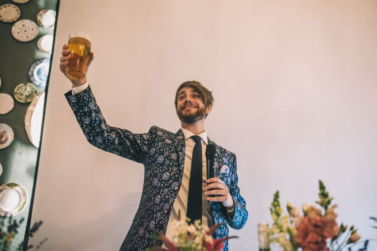 Groom In Patterned Suit Making Toast