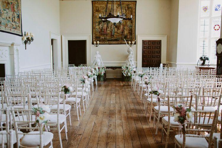 Indoor Ceremony At Elmore Court // Larkspur & Delphinium Wedding Flowers Elmore Court Gloucestershire Bride Pronovias Calligraphy Pale Press Flowers By The Rose Shed Images David Jenkins