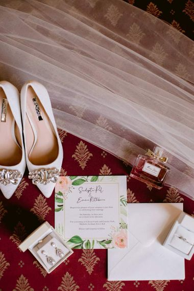 Embellished wedding shoes with wedding stationery
