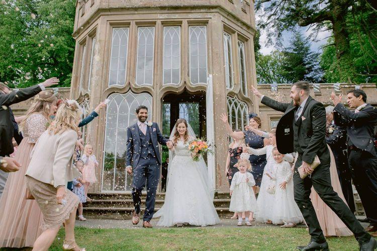 Confetti exit for bride and groom at Culzean Castle wedding in Scotland
