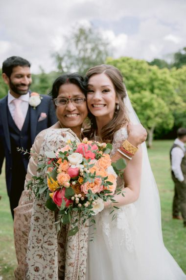 Bride greets wedding guests with bright bouquet