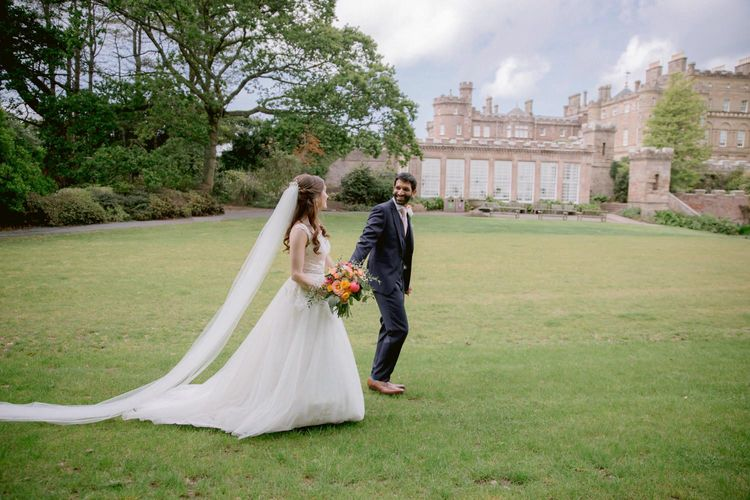 Bride in princess dress and long veil with  groom at Culzean Castle wedding in Scotland