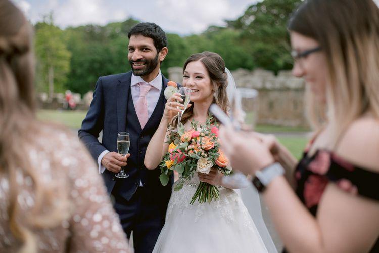 Bride and groom enjoy drinks outside at Culzean Castle wedding in Scotland