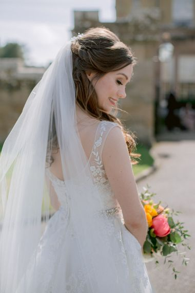 Lace detail wedding dress with veil and half up half down hair do