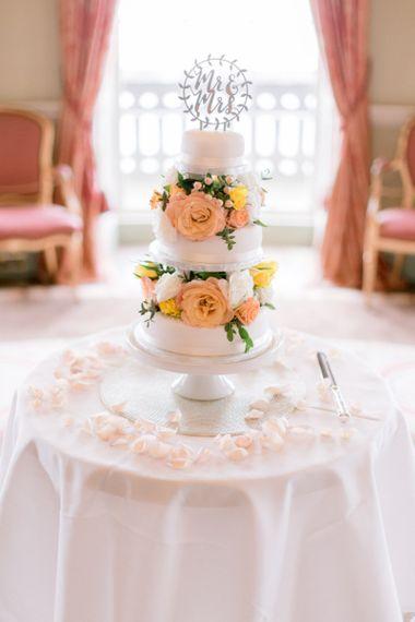 Wedding cake with bright wedding flower decor
