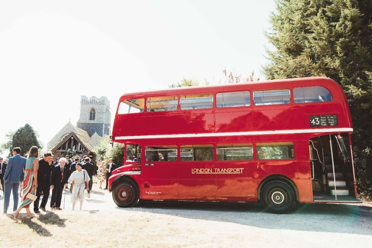 Red London Bus Wedding Transport   Quintessential English Country Wedding in Glass Marquee at Family Home   Maryanne Weddings Photography