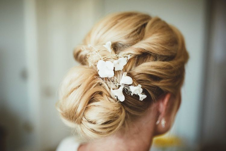 Bridal Up Do with Floral Hairpiece   Quintessential English Country Wedding in Glass Marquee at Family Home   Maryanne Weddings Photography
