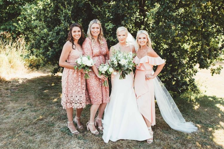 Bride in Essense of Australia Dress with Spaghetti Straps and Fishtail   Floor Length Veil   Bridesmaids in Mismatched Pink Dresses   Bouquets of White Flowers and Greenery   Quintessential English Country Wedding in Glass Marquee at Family Home   Maryanne Weddings Photography