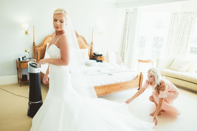 Final Preparations   Bride in Essense of Australia Dress with Spaghetti Straps and Fishtail   Floor Length Veil   Bridesmaid in Soft Pink Cold Shoulder Dress   Quintessential English Country Wedding in Glass Marquee at Family Home   Maryanne Weddings Photography