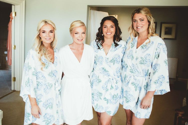 Wedding Morning Preparations   Bride and Bridesmaids   Bride in White Getting Ready Robe   Bridesmaids in Blue Floral Getting Ready Robes   Quintessential English Country Wedding in Glass Marquee at Family Home   Maryanne Weddings Photography