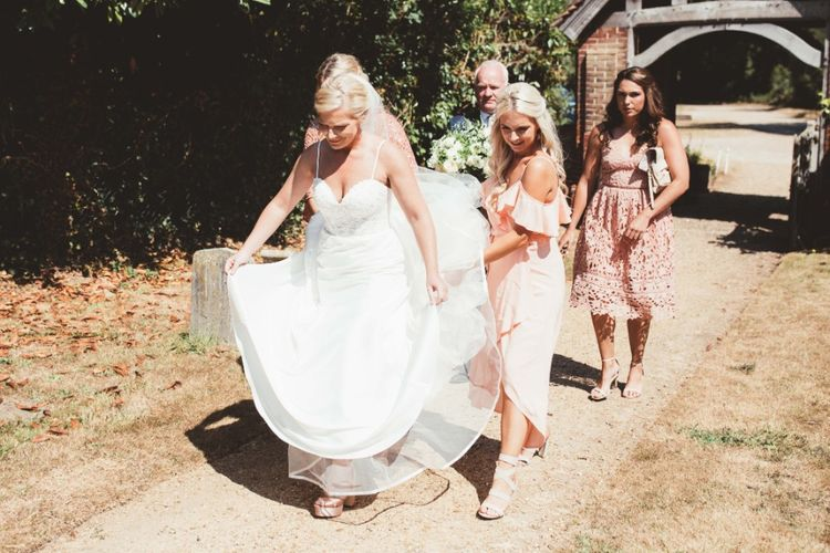 Arrival of the Bride   Bride in Essense of Australia Dress with Spaghetti Straps and Fishtail   Floor Length Veil   Bridesmaids in Mismatched Pink Dresses   Bridal Bouquet of White Flowers and Greenery   Quintessential English Country Wedding in Glass Marquee at Family Home   Maryanne Weddings Photography