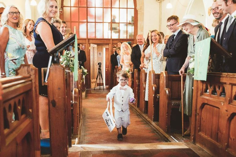 Wedding Ceremony   Page Boy in Grey Waistcoat and Pink Bow Tie   Quintessential English Country Wedding in Glass Marquee at Family Home   Maryanne Weddings Photography