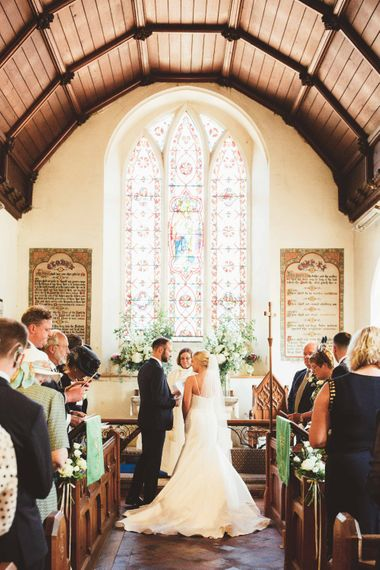 Wedding Ceremony   Bride in Essense of Australia Dress with Spaghetti Straps and Fishtail   Floor Length Veil   Groom in Blue Suit with White and Green Buttonhole   Quintessential English Country Wedding in Glass Marquee at Family Home   Maryanne Weddings Photography