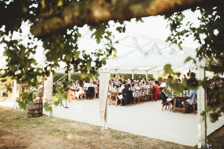Wedding Reception   Glass Marquee   Long Wooden Farmhouse Tables   Quintessential English Country Wedding in Glass Marquee at Family Home   Maryanne Weddings Photography