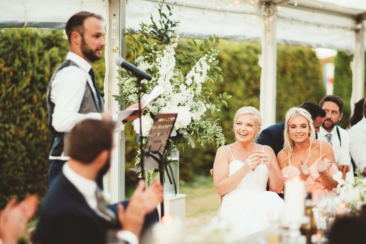 Groom's Speech   Glass Marquee with Open Sides   Bride in Essense of Australia Dress with Spaghetti Straps and Fishtail   Groom in Blue Suit with Grey Waistcoat   Quintessential English Country Wedding in Glass Marquee at Family Home   Maryanne Weddings Photography