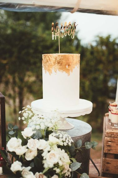 Tall One Tier Wedding Cake with Gold Leaf   Gold Mr and Mrs Cake Topper   Quintessential English Country Wedding in Glass Marquee at Family Home   Maryanne Weddings Photography
