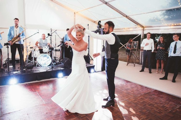 First Dance   Bride in Essense of Australia Dress with Spaghetti Straps and Fishtail   Groom in Blue Suit with Grey Waistcoat   Glass Marquee with Open Sides   Quintessential English Country Wedding in Glass Marquee at Family Home   Maryanne Weddings Photography